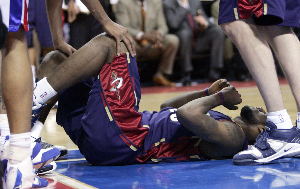 . Cleveland Cavaliers forward LeBron James is helped up after hitting the floor in the second quarter of Game 7 of an NBA basketball playoff series against the Detroit Pistons at the Palace in Auburn Hills, Mich., Sunday, May 21, 2006.  (AP Photo/Paul Sancya)