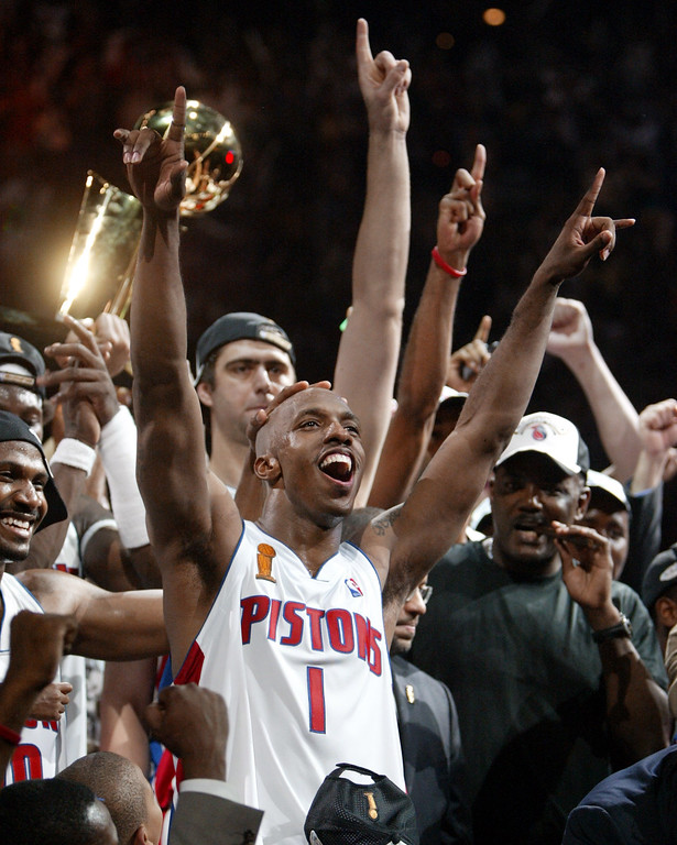 . FILE - In this June 15, 2004, file photo, Detroit Pistons guard Chauncey Billups and teammates celebrate their 100-87 win over the Los Angeles Lakers for the NBA championship at the Palace of Auburn Hills, Mich. Detroit had only the sixth-best record in the NBA before the playoffs that year. (AP Photo/Paul Sancya, File)
