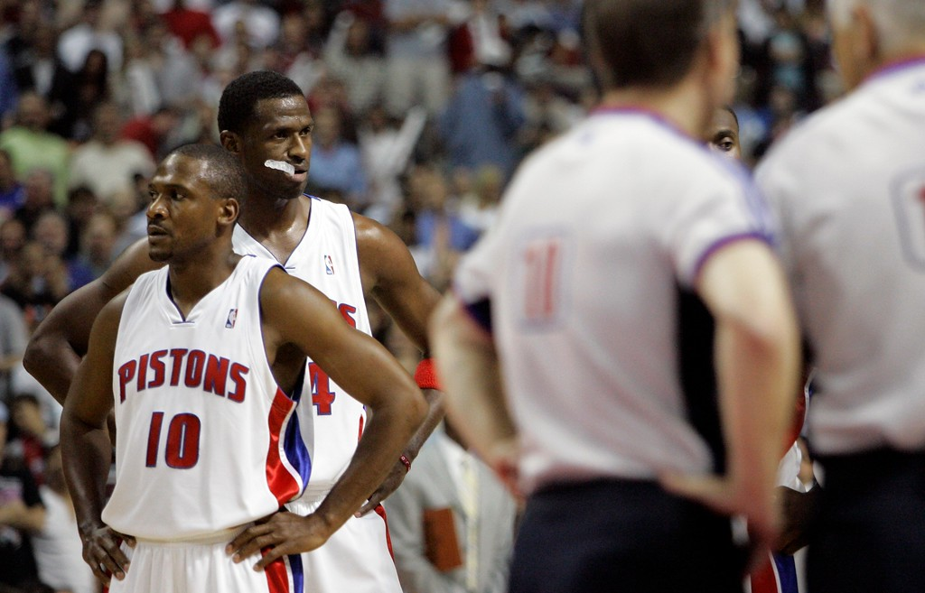 . Detroit Pistons forward Antonio McDyess, standing behind guard Lindsey Hunter (10), waits as the referees discuss his foul against Cleveland Cavaliers center Anderson Varejao during the first quarter of an NBA Eastern Conference final basketball game at the Palace of Auburn Hills, Mich., Thursday, May 31, 2007. McDyess was ejected for the foul.  (AP Photo/Paul Sancya)