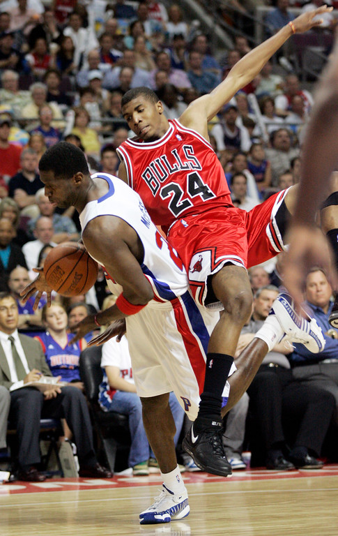 . Chicago Bulls forward Tyrus Thomas (24) lands on Detroit Pistons forward Antonio McDyess, left, while trying to defend a shot in the second half of Game 5 of an NBA second-round playoff basketball series Tuesday, May 15, 2007, in Auburn Hills, Mich. The Bulls beat the Pistons 108-92 to force Game 6. The Pistons lead the series 3-2. (AP Photo/Duane Burleson)