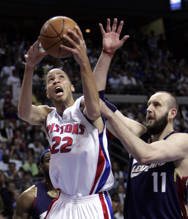 . Detroit Pistons forward Tayshaun Prince (22) is fouled by Cleveland Cavaliers center Zydrunas Ilgauskas, of Lithuania, during the fourth quarter of Game 7 in the NBA basketball playoffs at the Palace in Auburn Hills, Mich., Sunday, May 21, 2006. Prince scored 20 points in the Pistons\' 79-61 win. (AP Photo/Paul Sancya)