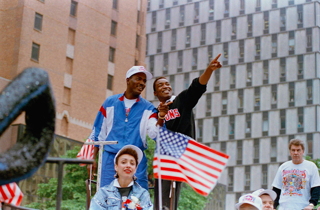 . Joe Dumars, left, and Isiah Thomas of the Detroit Pistons react to the fans as they parade in downtown Detroit, Mich., as the city honors the Pistons for their NBA World Championship, June 15, 1989. The Pistons defeated the Los Angeles Lakers in four straight games. Thousands of fans lined the parade route. (AP Photo/Lennox McLendon)