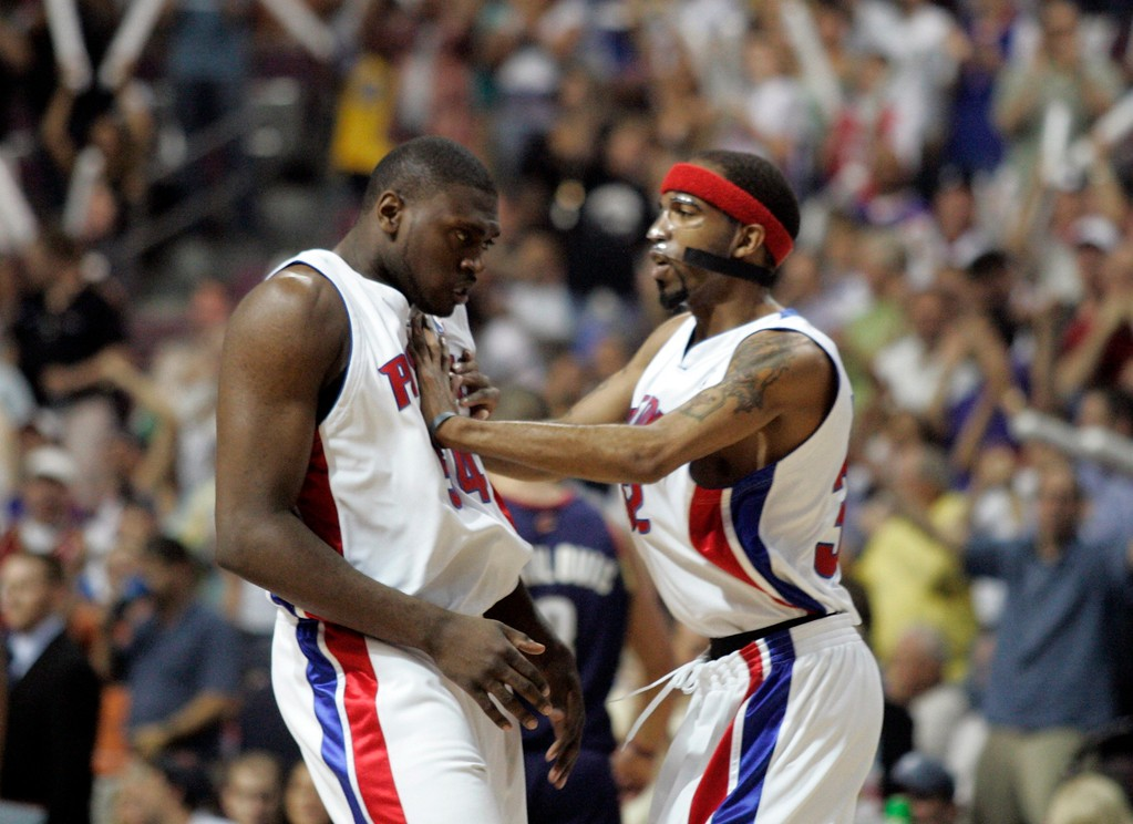 . Detroit Pistons forward Jason Maxiell, left, and guard Richard Hamilton react after Maxiell completed a dunk in the first quarter of Game 2 of an Eastern Conference finals NBA playoff basketball game at the Palace of Auburn Hills, Mich., Thursday, May 24, 2007. (AP Photo/Duane Burleson)