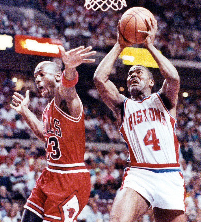 . ** FILE ** Detroit Pistons\' Joe Dumars (4) makes a layup as Chicago Bulls Michael Jordan reaches in during the first quarter of their seventh and deciding game of the NBA Eastern Conference Finals at the Palace of Auburn Hills, Mich., June 3, 1990. Dumars is going into the Basketball Hall of Fame, Friday, Sept. 8, 2006, and it\'s fitting that the former Detroit Pistons great will be inducted with the loquacious Charles Barkley and the spectacular Dominique Wilkins. (AP Photo/Duane Burleson)
