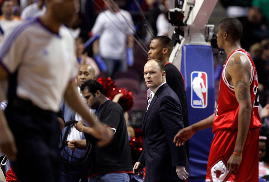 . Chicago Bulls coach Scott Skiles, center, looks back toward the court after the Bulls\' 108-87 loss to the Detroit Pistons in an Eastern Conference semifinal NBA playoff basketball game at the Palace of Auburn Hills, Mich., Monday, May 7, 2007. In the foreground left is official Leon Wood; forward Adrian Griffin is at right in red and forward P.J. Brown is directly behind Skiles in black. (AP Photo/Carlos Osorio)