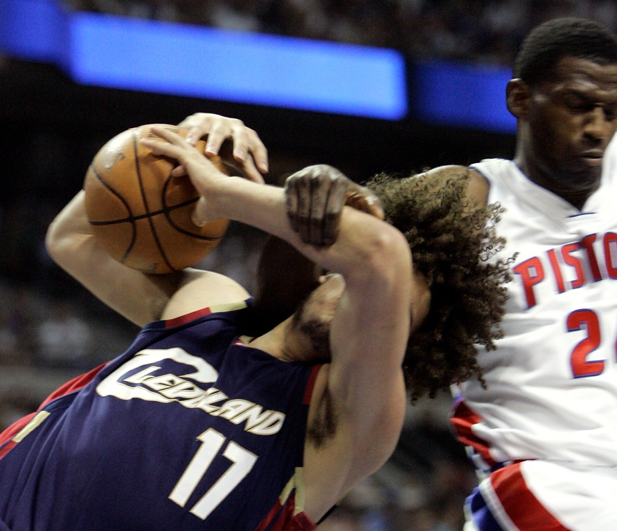 . Cleveland Cavaliers center Anderson Varejao, of Brazil, is fouled by Detroit Pistons forward Antonio McDyess, right, during the first quarter of an NBA Eastern Conference final basketball game at the Palace of Auburn Hills, Mich., Thursday, May 31, 2007. McDyess was ejected for the foul. (AP Photo/Paul Sancya)