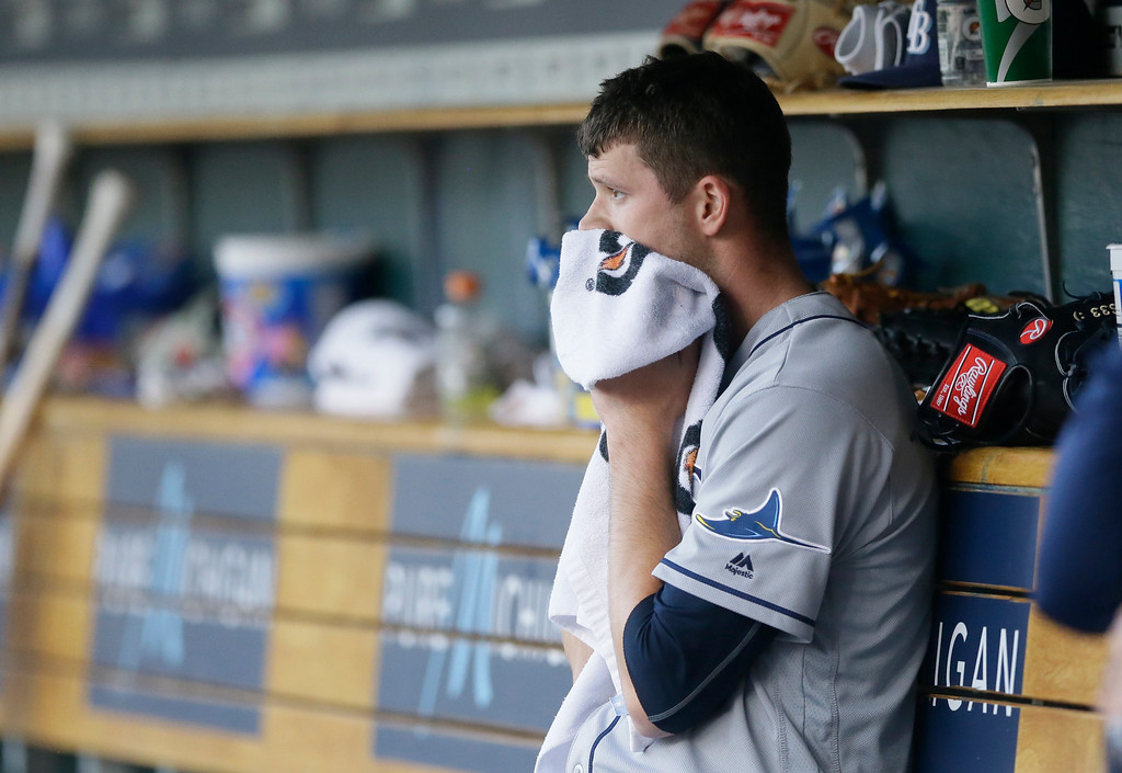 . Tampa Bay Rays starting pitcher Drew Smyly wipes his face in the dugout after being relieved during the seventh inning of a baseball game against the Detroit Tigers, Saturday, May 21, 2016, in Detroit. (AP Photo/Carlos Osorio)