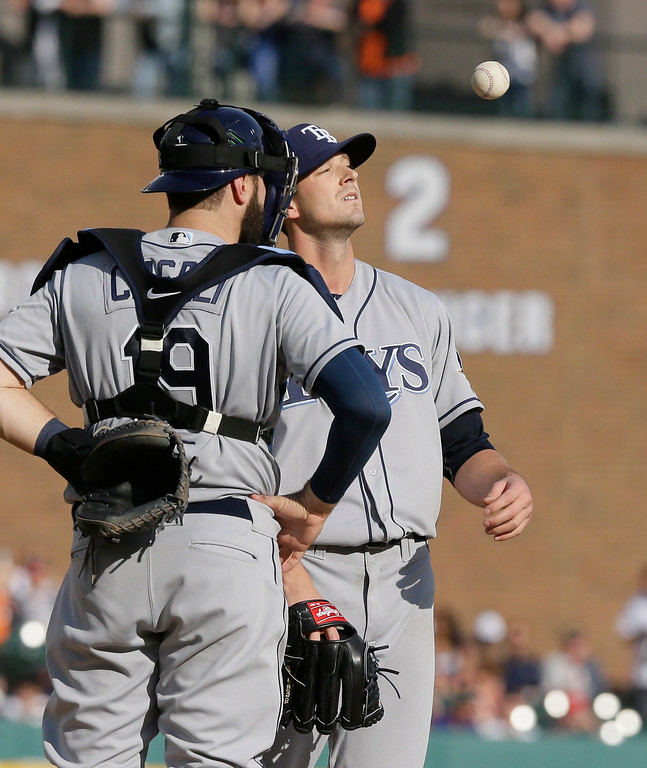 . Tampa Bay Rays starting pitcher Drew Smyly tosses the ball before being relieved during the seventh inning of a baseball game against the Detroit Tigers, Saturday, May 21, 2016, in Detroit. (AP Photo/Carlos Osorio)