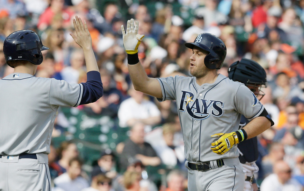 . Tampa Bay Rays\' Evan Longoria is greeted by teammates after hitting a solo home run during the sixth inning of a baseball game against the Detroit Tigers, Saturday, May 21, 2016, in Detroit. (AP Photo/Carlos Osorio)