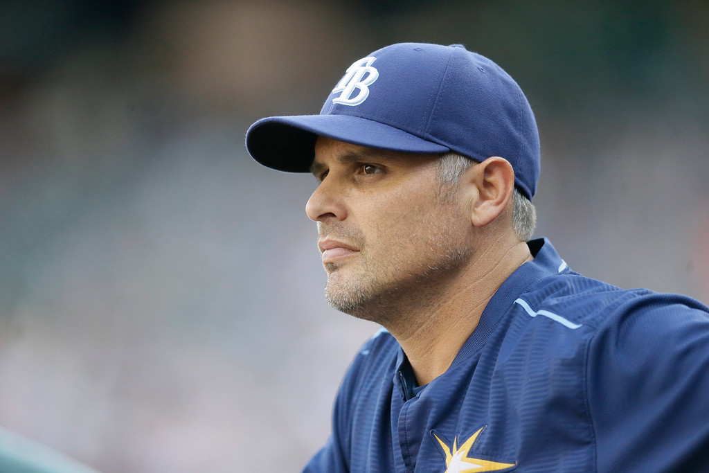 . Tampa Bay Rays manager Kevin Cash looks out from the dugout during the seventh inning of a baseball game against the Detroit Tigers, Saturday, May 21, 2016, in Detroit. (AP Photo/Carlos Osorio)