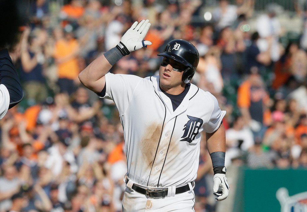 . Detroit Tigers\' James McCann rounds third base after his two-run home run during the seventh inning of a baseball game against the Tampa Bay Rays, Saturday, May 21, 2016, in Detroit. (AP Photo/Carlos Osorio)