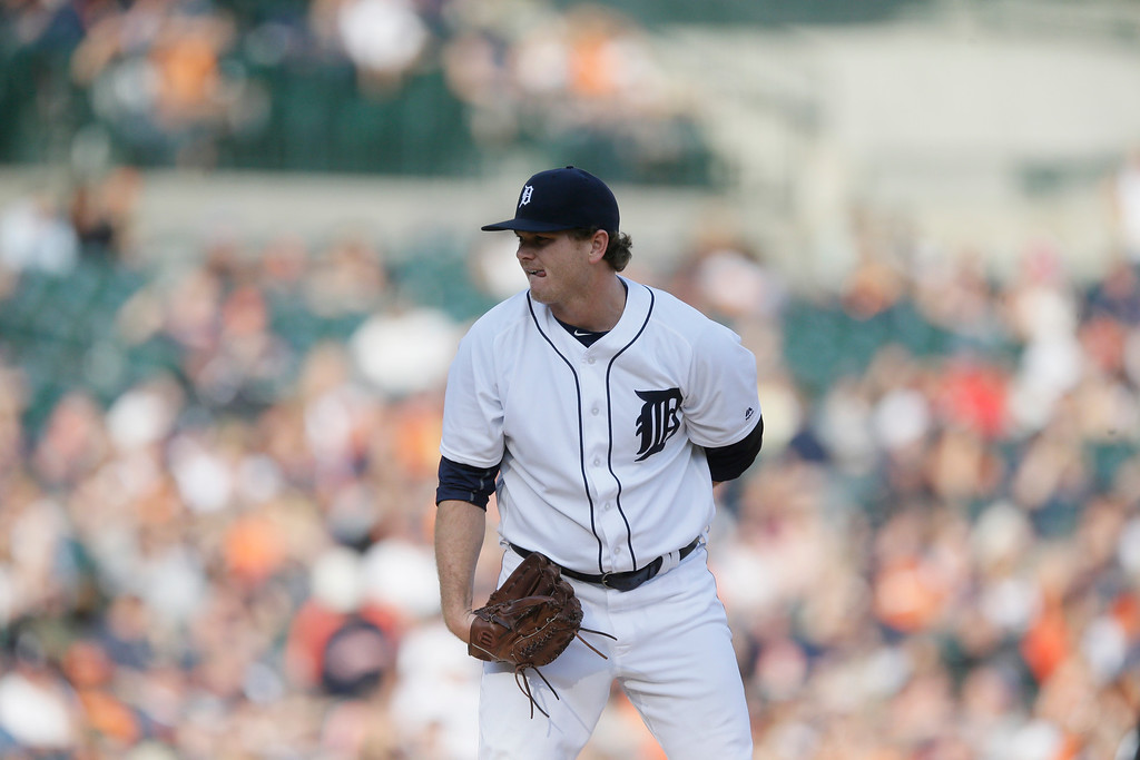 . Detroit Tigers relief pitcher Justin Wilson prepares to throw during the eighth inning of a baseball game against the Tampa Bay Rays, Saturday, May 21, 2016, in Detroit. (AP Photo/Carlos Osorio)