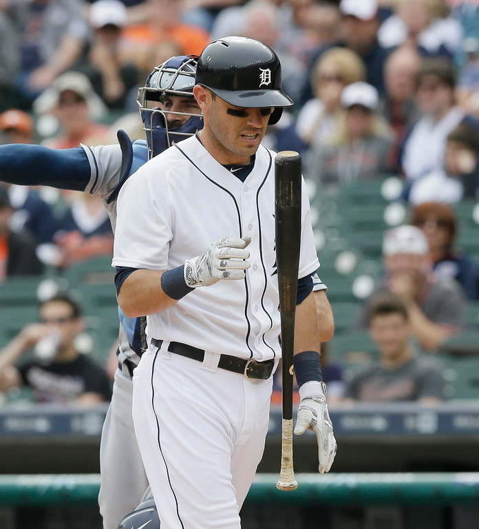 . Detroit Tigers\' Ian Kinsler flips his bat after striking out during the first inning of a baseball game against the Tampa Bay Rays, Saturday, May 21, 2016, in Detroit. (AP Photo/Carlos Osorio)