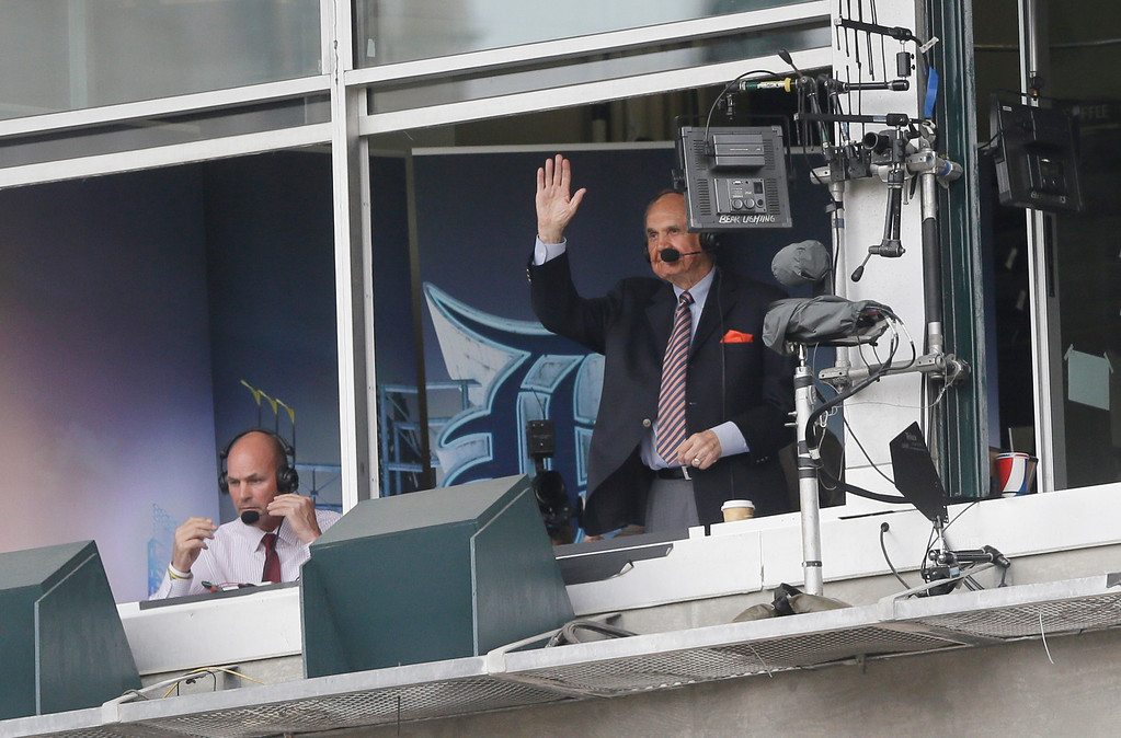 . Sportscastere Dick Enberg acknowledges the crowd during the first inning of a baseball game between the Detroit Tigers and the Tampa Bay Rays, Saturday, May 21, 2016, in Detroit. (AP Photo/Carlos Osorio)