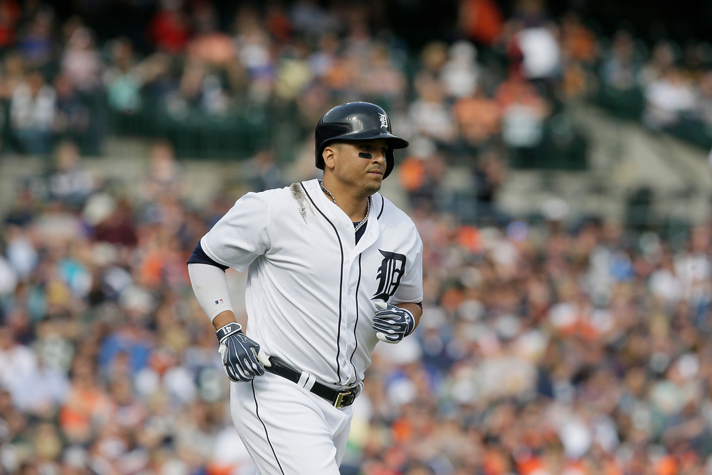 . Detroit Tigers designated hitter Victor Martinez runs to first during the fourth inning of a baseball game against the Tampa Bay Rays, Saturday, May 21, 2016, in Detroit. (AP Photo/Carlos Osorio)