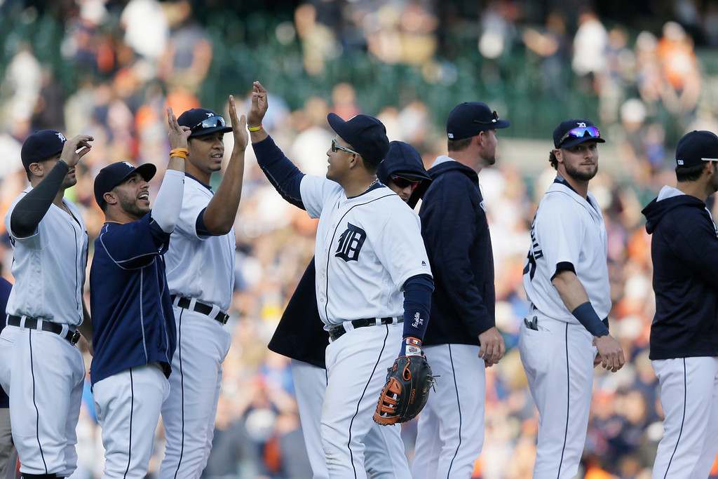 . Detroit Tigers first baseman Miguel Cabrera, center, greets teammates after a baseball game against the Tampa Bay Rays, Saturday, May 21, 2016, in Detroit. The Tigers defeated the Rays 5-4. (AP Photo/Carlos Osorio)