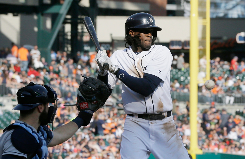 . Detroit Tigers\' Cameron Maybin is brushed back by an inside pitch during the seventh inning of a baseball game against the Tampa Bay Rays, Saturday, May 21, 2016, in Detroit. (AP Photo/Carlos Osorio)