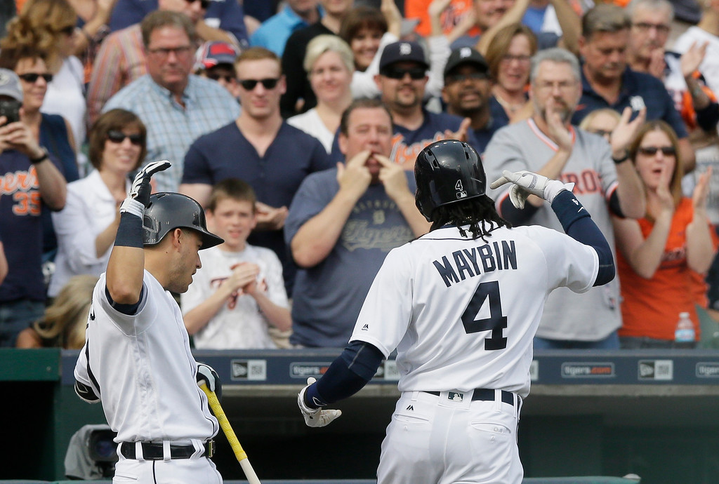 . Detroit Tigers\' Cameron Maybin is acknowledged by the crowd after his solo home run during the third inning of a baseball game against the Tampa Bay Rays, Saturday, May 21, 2016, in Detroit. (AP Photo/Carlos Osorio)