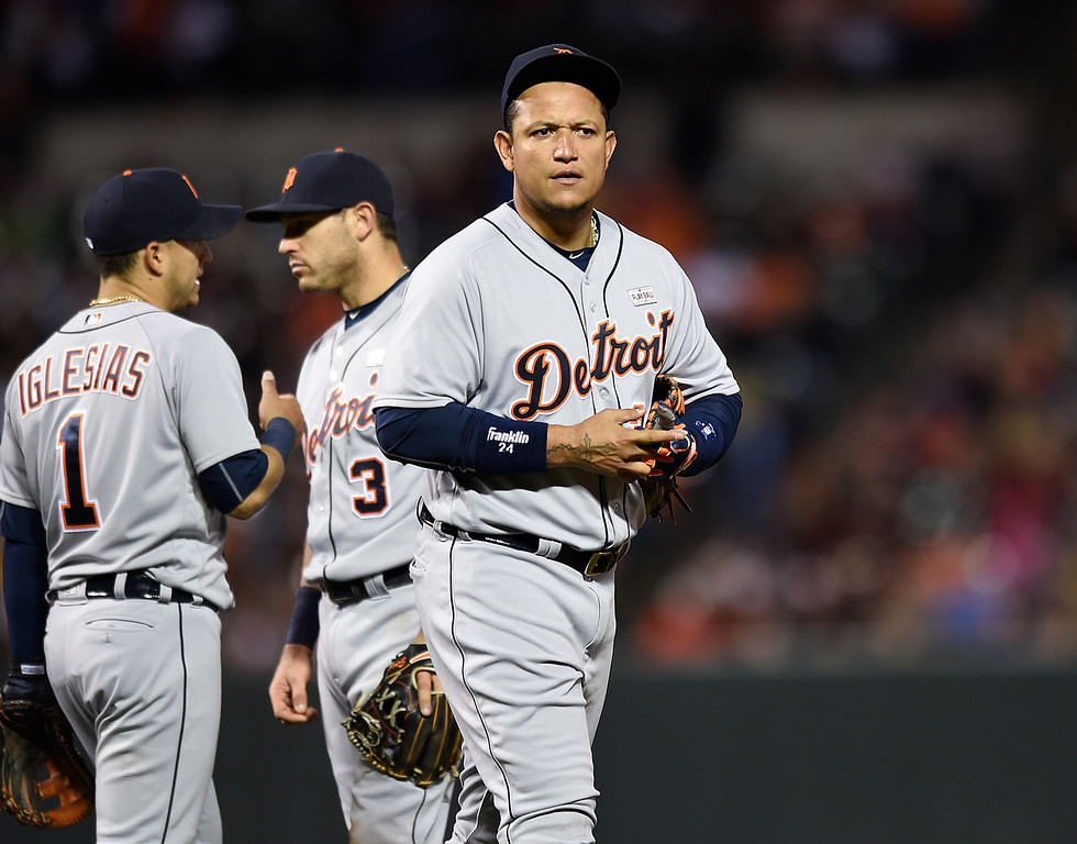 . Detroit Tigers first baseman Miguel Cabrera walks back to his position after a pitching change during the eighth inning of a baseball game against the Baltimore Orioles on Saturday, May 14, 2016, in Baltimore. The Orioles won 9-3. (AP Photo/Gail Burton)