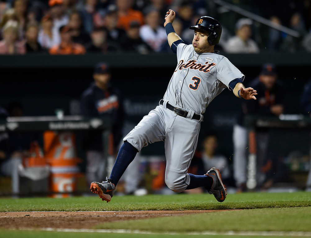 . Detroit Tigers\' Ian Kinsler slides safely into home on a single by Victor Martinez during the eighth inning of a baseball game against the Baltimore Orioles on Saturday, May 14, 2016, in Baltimore. The Orioles won 9-3. (AP Photo/Gail Burton)