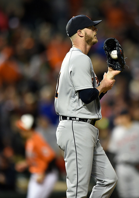 . Detroit Tigers pitcher Mark Lowe walks to the mound after giving up a grand slam to Baltimore Orioles\' Jonathan Schoop during the eighth inning of a baseball game Saturday, May 14, 2016, in Baltimore. The Orioles won 9-3. (AP Photo/Gail Burton)
