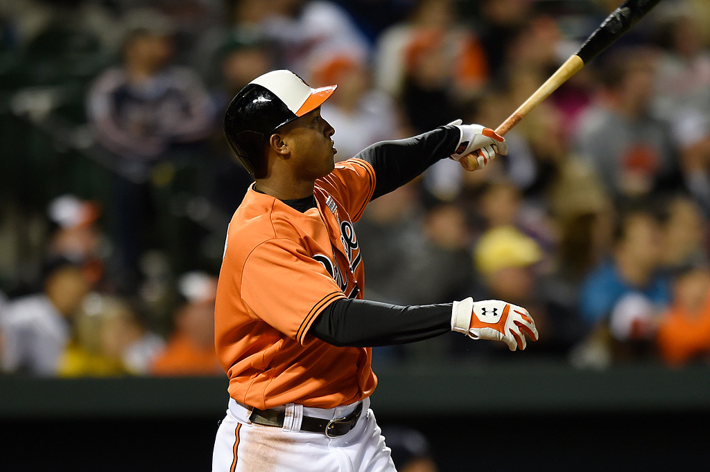 . Baltimore Orioles\' Jonathan Schoop watches his grand slam against the Detroit Tigers during the eighth inning of a baseball game, Saturday, May 14, 2016, in Baltimore. The Orioles won 9-3. (AP Photo/Gail Burton)