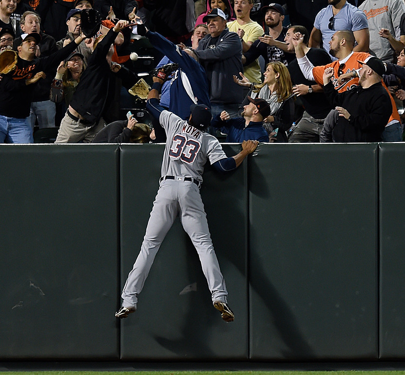 . Detroit Tigers left fielder Steven Moya leaps but can\'t reach a solo home run by Baltimore Orioles\' Adam Jones during the eighth inning of a baseball game Saturday, May 14, 2016, in Baltimore. The Orioles won 9-3. (AP Photo/Gail Burton)