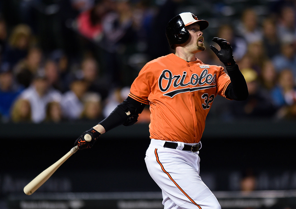 . Baltimore Orioles\' Matt Wieters watches his two-run home run against the Detroit Tigers during the sixth inning of a baseball game Saturday, May 14, 2016, in Baltimore. The Orioles won 9-3. (AP Photo/Gail Burton)