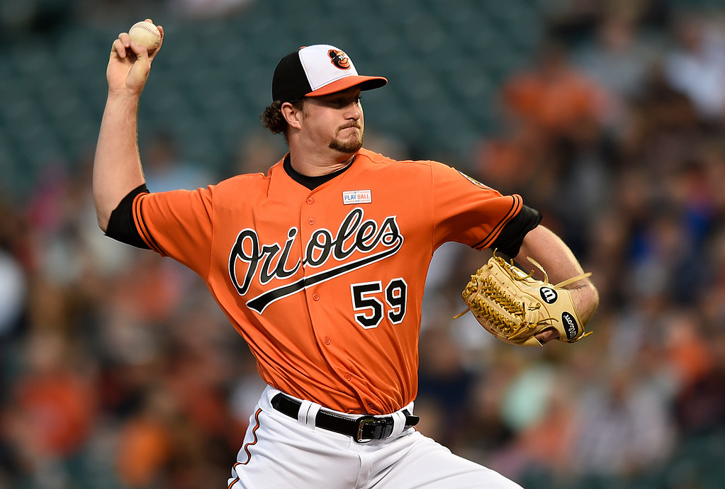 . Baltimore Orioles pitcher Mike Wright delivers against the Detroit Tigers during the first inning of a baseball game, Saturday, May 14, 2016, in Baltimore. (AP Photo/Gail Burton)