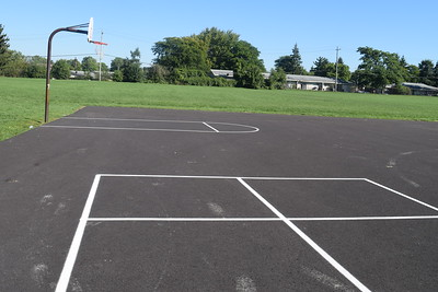 A newly-paved basketball court at Alcott Elementary School. The basketball hoops and nets have yet to be renovated. Photo: Anthony Spak/For The Oakland Press.