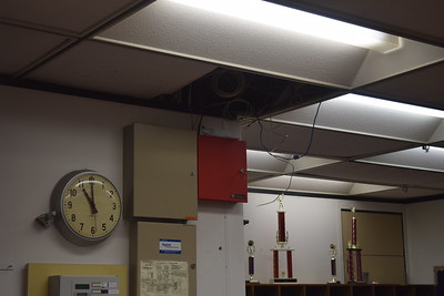 Wires hang from an opening in the ceiling tiles in the main office of Pontiac High School on Monday, Sept. 19, 2016. Photo: Anthony Spak/For The Oakland Press.