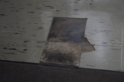 Broken floor tiles at Pontiac High School were not replaced as part of the inital sinking fund renovations. Photo: Anthony Spak/For The Oakland Press.