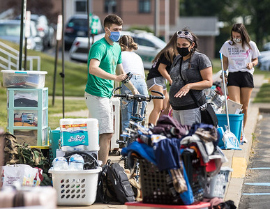 Hello,Could you scan these in for Sunday's edition with the caption: Masked Slippery Rock University students moved into their dormitories Friday. Photo courtesy of Slippery Rock University.