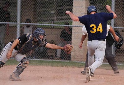 Mars' #34 beats a play at the plate from Cranberry catcher to score Mars final run. Seb Foltz/Butler Eagle