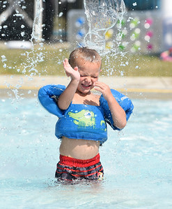 James Powers, 4, of Slippery Rock cooled off at the Alameda Waterpark with his mother Courtney Powers, Monday, August, 10, 2020. Harold Aughton/Butler Eagle: