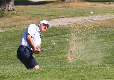 Rob Voltz swings from a sand trap on the back nine during Saturday's Butler Eagle County Amateur Saturday at Lake Arthur Golf Club. Seb Foltz/Butler Eagle. Aug. 2020