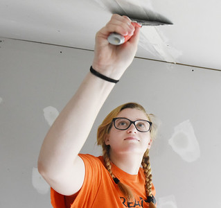 Ashley Magle, 21, plasters the tape as part of the Chicora Alliance Church home renovation project on E. Slippery Rock Street Wednesday, August 12, 2020. Harold Aughton/Butler Eagle