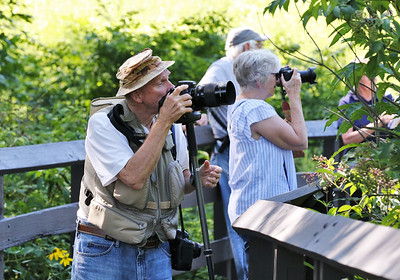 Local retired photographer Rick Shannon of Butler and other park guests look for butterflies at the Jennings Environmental Education Center Wednesday. Seb Foltz/Butler Eagle 08/05/20