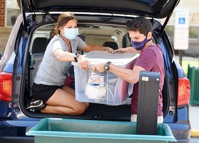 Ilisa Chasser, 19, of Lancaster, helps her twin, Dean Chasser, 19, move into his dorm at Slippery Rock University, Monday, August 10, 2020.  Harold Aughton/Butler Eagle