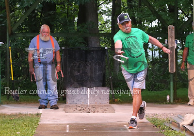 Bud Neff of Herman throws a horseshoe against Ron Hans Tuesday night in a league game between the Dew Drop Inn and O'Donnell's Distributor(Green) at the Dew Drop Inn Tuesday. Seb Foltz/Butler Eagle 08/04/20
