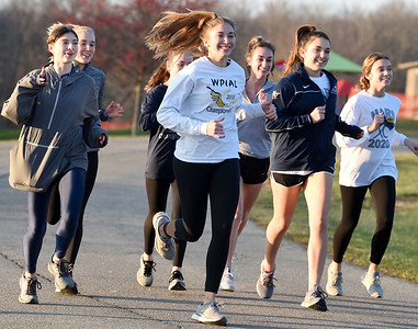 The Mars girls cross country team worked out after school at the Adams Twp. Community Park Thursday afternoon, December 10, 2020. Harold Aughton/Butler Eagle.