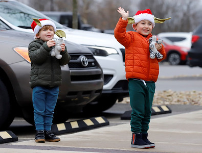 Reese Skender(right), 5, and his brother Cameron, 3, wave to Santa in Graham Park during Saturday's Cranberry Township Santa parade. Emergency responders passed through Cranberry's major parks with Santa before concluding at the township municipal building. Seb Foltz/Butler Eagle 12/05/20