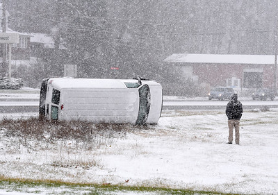 The driver of a van waits for a tow truck after losing control of his van along Route 8 in Butler Twp. Wednesday afternoon December 16, 2020. Harold Aughton/Butler Eagle.