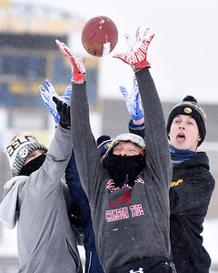 Mars juniors, Brendan Koroly,Trevin Seskey, Ryan Mitchell and Ty Garver go up for a pass during a pickup game of football after school Thursday afternoon, December 17, 2020. Harold Aughton/Butler Eagle.