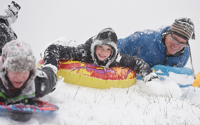 Michael Bridgeman, left, 14, of Valencia spent the afternoon sled riding with his brother Jacob, 11, and dad Jim Bridgeman at Glade Run Lake Wednesday, December 16 2020. Harold Aughton/Butler Eagle.