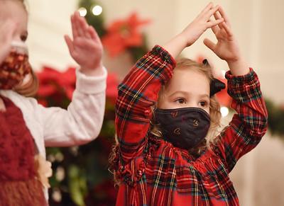 Pre-schoolers Charlie Foringer, 5, left, and Harper Jackson, 4, sing and perform during the Butler Montessori school's Christmas program. Harold Aughton/Butler Eagle.