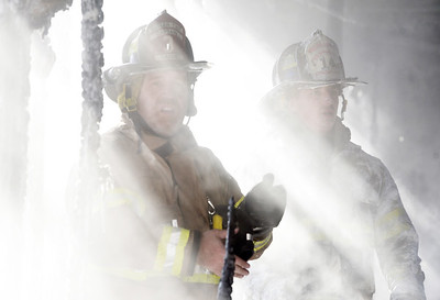 Firefighters Captain Joe Ladu of Butler Twp., and Shaun Milkovich, assistant chief at Unionville fire departments, look for hot spots following a fire at 136 Caravan Court in Center Township Thursday, December 3, 2020.  Harold Aughton/Butler Eagle.