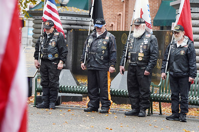 Members of the American Legion Riders, from left, Navy veteran LeRoy Bunyan, Airforce veteran Mike Shook, Army veteran Dennis Christie and Marine veteran Bob Hicks, bow their heads in a moment of silence during the Veterans Day memorial service held in Diamond Park, November 11, 2020. Harold Aughton/Butler Eagle