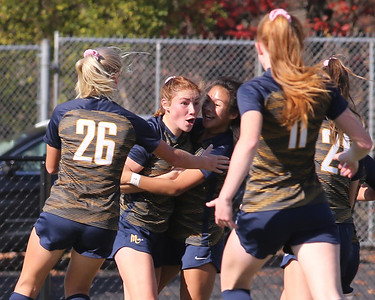 Mars' Ellie Coffield (left center) and Erin Rodgers celebrate Rodgers goal with teammates in Saturday's WPIAL  Championship. Caufield setup Rodgers on a corner kick to score the teams lone goal. Mars topped Plum 1-0 to earn back-to-back titles. Seb Foltz/Butler Eagle 11/7/20