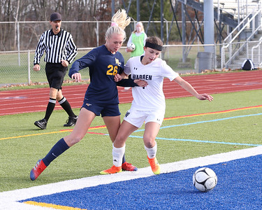 Mars' Ava Lewis fights off a challenge from Warren defender Lennon Daily  in Saturday's PIAA playoff at Mars. Mars topped Warren 8-0. Seb Foltz/Butler Eagle 11/14/20